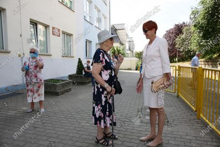 Stock Picture of Member of the European Parliament Elzbieta Rafalska (R) on the way to polling station during Poland's presidential elections in Gorzow Wielkopolski, Poland, 28 June 2020. Poles are voting to elect their president for a five-year term. The vote had been due to take place on 10 May but was delayed by the COVID-19 pandemic. Polling stations are open in Poland from 7 a.m. to 9 p.m. If none of the eleven contenders in the race wins more than 50 percent of the vote, under Polish election rules, a second round will be held on 12 July.