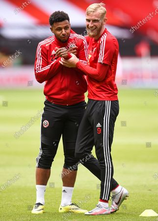 Oli McBurnie (R) and Lys Mousset (L) of Sheffield prior to the English FA Cup quarter final match between Sheffield United and Arsenal London in Sheffield, Britain, 28 June 2020.