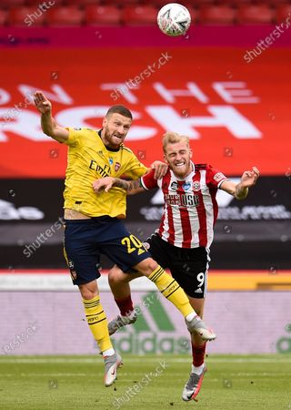 Oli McBurnie (R) of Sheffield in action against Shkodran Mustafi (L) of Arsenal during the English FA Cup quarter final match between Sheffield United and Arsenal London in Sheffield, Britain, 28 June 2020.