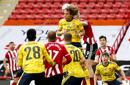 David Luiz (C-L) of Arsenal in action against Oli McBurnie C-R) of Sheffield during the English FA Cup quarter final match between Sheffield United and Arsenal London in Sheffield, Britain, 28 June 2020.