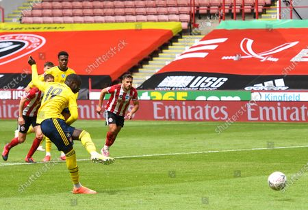 Nicolas Pepe of Arsenal scores from the penalty during the English FA Cup quarter final match between Sheffield United and Arsenal London in Sheffield, Britain, 28 June 2020.