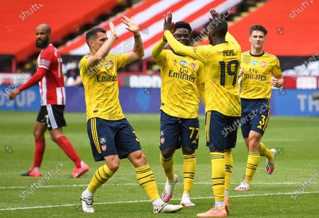 Nicolas Pepe (2-R) of Arsenal celebrates with teammates after scoring opening goal during the English FA Cup quarter final match between Sheffield United and Arsenal London in Sheffield, Britain, 28 June 2020.
