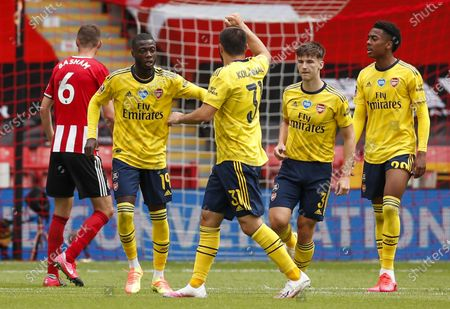 Nicolas Pepe (2-L) of Arsenal celebrates with teammates after scoring opening goal during the English FA Cup quarter final match between Sheffield United and Arsenal London in Sheffield, Britain, 28 June 2020.