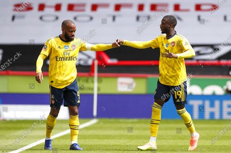 Nicolas Pepe (R) of Arsenal celebrates with teammate Alexandre Lacazette (L) after scoring opening goal during the English FA Cup quarter final match between Sheffield United and Arsenal London in Sheffield, Britain, 28 June 2020.