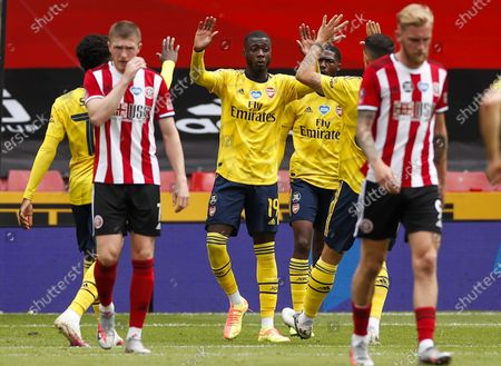 Nicolas Pepe (C) of Arsenal celebrates with teammates after scoring opening goal during the English FA Cup quarter final match between Sheffield United and Arsenal London in Sheffield, Britain, 28 June 2020.