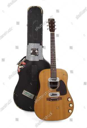 Nirvana music icon Kurt Cobaina's guitar used during the band's MTV Unplugged concert has become the most expensive guitar in history, selling for just over $6 million USD at auction.That is six times the original estimated price of $1 million.The final price was $6,010,000 USD / €5,376,945 Euros The sale set five new world records --world's most expensive guitar, world's most expensive acoustic guitar, most expensive guitar made by US company Martin and world's most expensive piece of memorabilia;The buyer was Peter Freedman, founder of high end Australia-based microphone manufacturer Rode. He attended the live auction in Beverly Hills, California, staged by Juliena's Auctions and successfully won the guitar in a bidding war among collectors and bidders all across the globe. Bidders participated live on the floor, online and on the phone.Mr. Freedman plans to display the guitar in a worldwide tour of exhibitions to be held in distinguished galleries and art spaces, with all proceeds going to the performing arts.Pix: Kurt Cobain's Unplugged electro-acoustic Martin guitar which sold for just over $6 million dollars