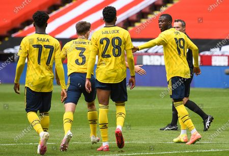 Nicolas Pepe (R) of Arsenal celebrates with teammates after scoring the opening goal during the English FA Cup quarter final match between Sheffield United vs Arsenal London in Sheffield, Britain, 28 June 2020.