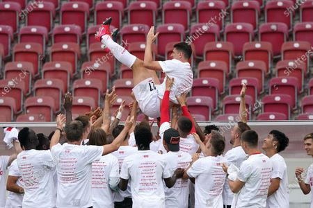 Stock Photo of Mario Gomez (up) of Stuttgart is celebrated by teammates after his last game following the German Bundesliga Second Division soccer match between VfB Stuttgart and SV Darmstadt 98 in Stuttgart, Germany, 28 June 2020.