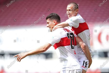 Mario Gomez (L) of Stuttgart celebrates with teammate Darko Churlinov (R) after scoring the 1-1 equalizer during the German Bundesliga Second Division soccer match between VfB Stuttgart and SV Darmstadt 98 in Stuttgart, Germany, 28 June 2020.