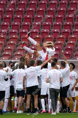 Mario Gomez (up) of Stuttgart is celebrated by teammates after his last game following the German Bundesliga Second Division soccer match between VfB Stuttgart and SV Darmstadt 98 in Stuttgart, Germany, 28 June 2020.