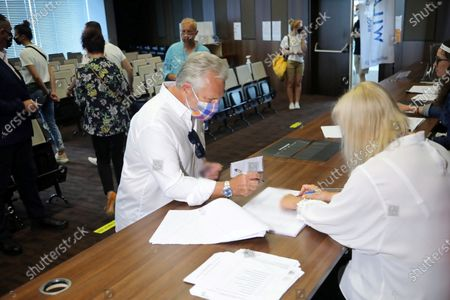 Former Polish President Aleksander Kwasniewski (L) vote at a polling station during Poland's presidential elections in Warsaw, Poland, 28 June 2020. Poles are voting to elect their president for a five-year term. The vote had been due to take place on 10 May but was delayed by the COVID-19 pandemic. Polling stations are open in Poland from 7 a.m. to 9 p.m. If none of the eleven contenders in the race wins more than 50 percent of the vote, under Polish election rules, a second round will be held on 12 July.