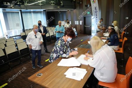 Former Polish President Aleksander Kwasniewski (L) with his wife Jolanta Kwasniewska (C) vote at a polling station during Poland's presidential elections in Warsaw, Poland, 28 June 2020. Poles are voting to elect their president for a five-year term. The vote had been due to take place on 10 May but was delayed by the COVID-19 pandemic. Polling stations are open in Poland from 7 a.m. to 9 p.m. If none of the eleven contenders in the race wins more than 50 percent of the vote, under Polish election rules, a second round will be held on 12 July.
