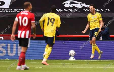 Dani Ceballos (R) of Arsenal celebrates after scoring the 2-1 lead during the English FA Cup quarter final soccer match between Sheffield United and Arsenal FC in Sheffield, Britain, 28 June 2020.