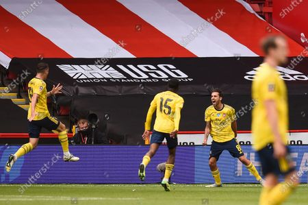 Dani Ceballos (2-R) of Arsenal celebrates after scoring the 2-1 lead during the English FA Cup quarter final soccer match between Sheffield United and Arsenal FC in Sheffield, Britain, 28 June 2020.