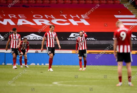 Sheffield players react after losing the English FA Cup quarter final soccer match between Sheffield United and Arsenal FC in Sheffield, Britain, 28 June 2020.