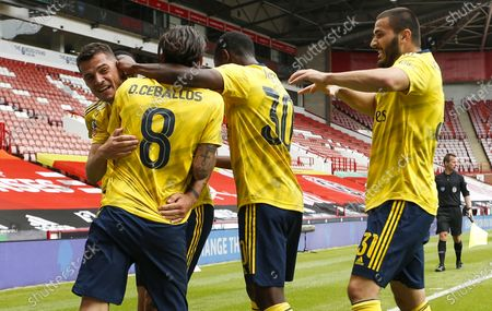 Dani Ceballos (2-L) of Arsenal celebrates with teammates after scoring the 2-1 lead during the English FA Cup quarter final soccer match between Sheffield United and Arsenal FC in Sheffield, Britain, 28 June 2020.