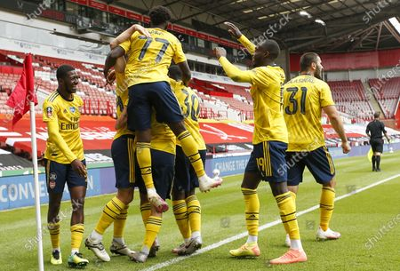 Arsenal players celebrate their 2-1 lead during the English FA Cup quarter final soccer match between Sheffield United and Arsenal FC in Sheffield, Britain, 28 June 2020.