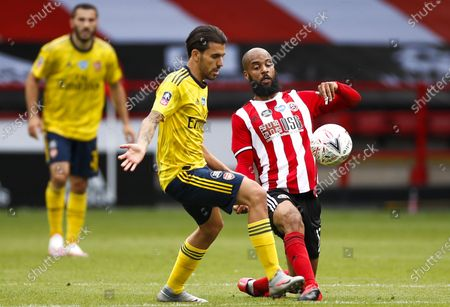 Dani Ceballos (C) of Arsenal in action against Sheffield's David McGoldrick (R) during the English FA Cup quarter final soccer match between Sheffield United and Arsenal FC in Sheffield, Britain, 28 June 2020.