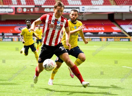 Sander Berge (front) of Sheffield in action during the English FA Cup quarter final soccer match between Sheffield United and Arsenal FC in Sheffield, Britain, 28 June 2020.