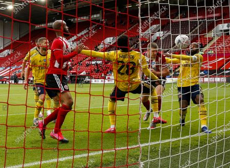 John Lundstram (2-R) of Sheffield scores a goal which was later disallowed by the VAR system during the English FA Cup quarter final soccer match between Sheffield United and Arsenal FC in Sheffield, Britain, 28 June 2020.