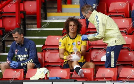 David Luiz (C) of Arsenal sits on the tribune after being injured during the English FA Cup quarter final soccer match between Sheffield United and Arsenal FC in Sheffield, Britain, 28 June 2020.