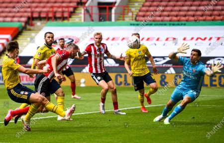 Chris Basham (2-L) of Sheffield in action during the English FA Cup quarter final soccer match between Sheffield United and Arsenal FC in Sheffield, Britain, 28 June 2020.