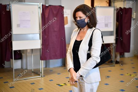 Agnes Buzyn, candidate for the presidential party La Republique en Marche (LREM) in the second round of municipal elections, waits to vote in Paris. France is holding the second round of municipal elections in 5,000 towns and cities Sunday that got postponed due to the country's coronavirus outbreak