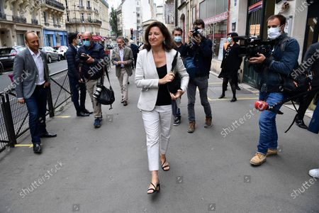 Agnes Buzyn, candidate for the presidential party La Republique en Marche (LREM) in the second round of municipal elections, leaves after voting in Paris. France is holding the second round of municipal elections in 5,000 towns and cities Sunday that got postponed due to the country's coronavirus outbreak
