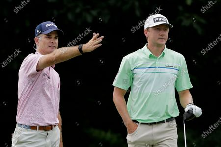 Kevin Streelman, left, motions in the direction a tee shot by Mackenzie Hughes, of Canada, went on the 13th hole during the final round of the Travelers Championship golf tournament at TPC River Highlands, in Cromwell, Conn