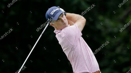 Kevin Streelman tees off on the 13th hole during the final round of the Travelers Championship golf tournament at TPC River Highlands, in Cromwell, Conn