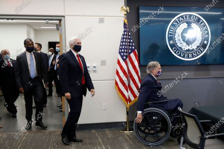 Texas Gov. Greg Abbott, right, is followed by Vice President Mike Pence, Housing and Urban Development Secretary Ben Carson and Dr. John Hellerstedt, left, Commissioner of the Texas Department of State Health Services as they arrive for a news conference after Pence met with Abbott and members of his health care team regarding COVID-19 at the University of Texas Southwestern Medical Center West Campus in Dallas