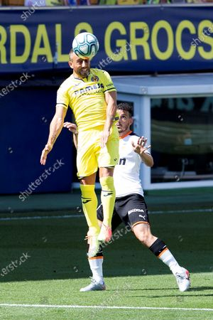 Villarreal CF's midfielder Santi Cazorla (L)  in action during the Spanish LaLiga soccer match between Villarreal and Valencia held at La Ceramica Stadium, in Villarreal, Spain, 28 June 2020.