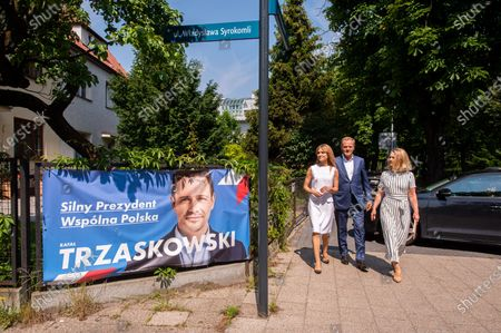 Katarzyna Tusk (L) Donald Tusk (C) and Malgorzata Tusk (R) walking past a banner with a portrait of Civil Platform (Platforma Obywatelska) presidential candidate, Rafal Trzaskowsk during the presidential election. Initially planned to take place on May 10th, but due to the coronavirus pandemic, the presidential elections in Poland were postponed.