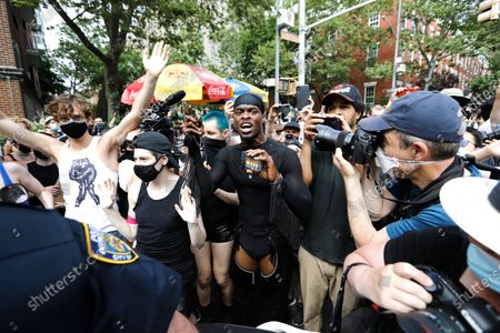 Protesters and police clash at the Queer March for Black Lives at Washington Square Park, in New York, New York, USA, 28 June 2020. Today, the 50th anniversary of the first gay rights march in the U.S. is celebrated with Black Lives Matter protests across multiply cities throughout America.