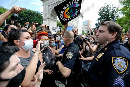 Protesters and police face off at the Queer March for Black Lives at Washington Square Park, in New York, New York, USA, 28 June 2020. Today, the 50th anniversary of the first gay rights march in the US is celebrated with Black Lives Matter protests across multiple cities throughout America.
