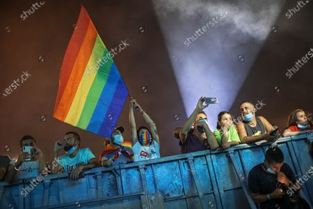 Hundreds of LGBT members and supporters attend a gay pride rally under strict health restrictions due to the coronavirus outbreak in Tel Aviv, Israel, . The rally has been down-scaled amid the coronavirus outbreak in Tel Aviv, which last year drew more than 250,000 people