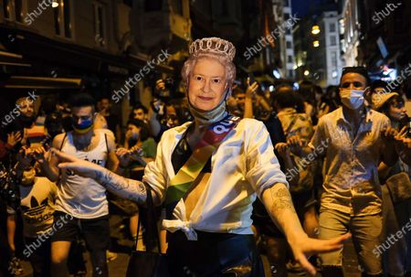 LGBTI (lesbian, gay, bisexual, transgender, and intersex) community members and supporters dance and wear a mask of the Britain's Queen Elizabeth II during the  Global Pride in Istanbul, Turkey, 28 June 2020.