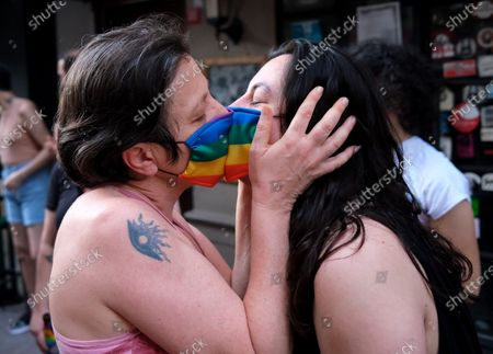 A couple kiss as they wear rainbow mask as LGBTI (lesbian, gay, bisexual, transgender, and intersex) community members and supporters take part during the Global Pride in Istanbul, Turkey, 28 June 2020.