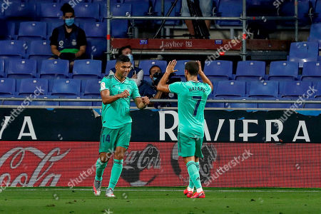 Real Madrid's Casemiro, left, is congratulated by Real Madrid's Eden Hazard after scoring the opening goal during the Spanish La Liga soccer match between RCD Espanyol and Real Madrid at the Cornella-El Prat stadium in Barcelona, Spain