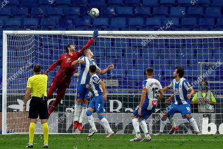 Espanyol's goalkeeper Diego Lopez clears the ball during the Spanish La Liga soccer match between RCD Espanyol and Real Madrid at the Cornella-El Prat stadium in Barcelona, Spain