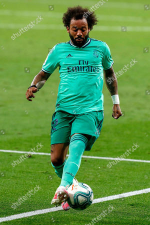 Real Madrid's Marcelo controls the ball during the Spanish La Liga soccer match between RCD Espanyol and Real Madrid at the Cornella-El Prat stadium in Barcelona, Spain