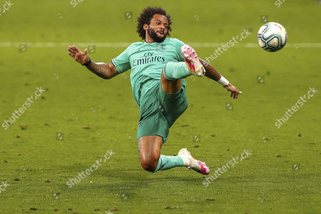 Real Madrid's Marcelo in action during the Spanish La Liga soccer match between RCD Espanyol and Real Madrid at the Cornella-El Prat stadium in Barcelona, Spain