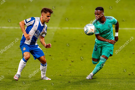 Real Madrid's Vinicius Junior, right, views for the ball with Espanyol's Oscar Melendo during the Spanish La Liga soccer match between RCD Espanyol and Real Madrid at the Cornella-El Prat stadium in Barcelona, Spain