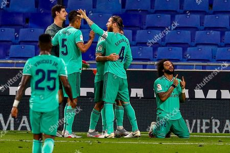 Real Madrid players celebrate their victory at the end of the Spanish La Liga soccer match against RCD Espanyol at the Cornella-El Prat stadium in Barcelona, Spain