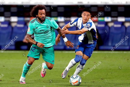 Espanyol's Wu Lei (R) in action against Real Madrid's Marcelo (L) during the Spanish LaLiga soccer match between RCD Espanyol and Real Madrid held at RCDE Stadium, in Barcelona, Spain, 28 June 2020.