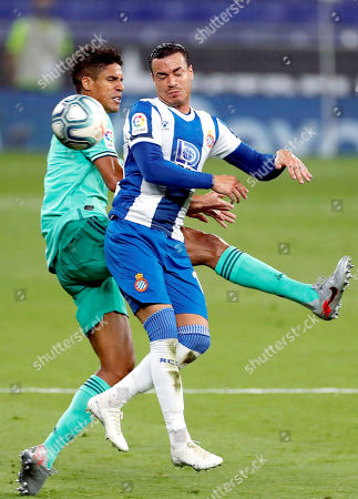 Espanyol's Raul de Tomas (R) in action against Real Madrid's Raphael Varane (L) during the Spanish LaLiga soccer match between RCD Espanyol and Real Madrid held at RCDE Stadium, in Barcelona, Spain, 28 June 2020.