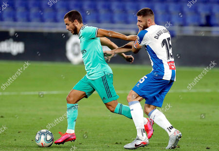 Espanyol's David Lopez (R) in action against Real Madrid's Eden Hazard (L) during the Spanish LaLiga soccer match between RCD Espanyol and Real Madrid held at RCDE Stadium, in Barcelona, Spain, 28 June 2020.