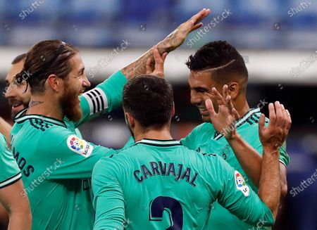 Real Madrid's Brazilian Carlos Henrique Casemiro (R) celebrates after scoring against RCD Espanyol during the Spanish LaLiga soccer match between RCD Espanyol and Real Madrid held at RCDE Stadium, in Barcelona, Spain, 28 June 2020.