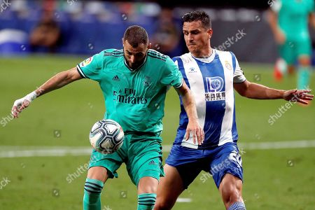 Real Madrid's Karim Benzema (L) in action against Bernardo Espinosa (R) of RCD Espanyol during the Spanish LaLiga soccer match between RCD Espanyol and Real Madrid held at RCDE Stadium, in Barcelona, Spain, 28 June 2020.