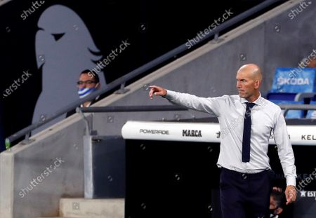 Real Madrid's head coach Zinedine Zidane gestures during the Spanish LaLiga soccer match between RCD Espanyol and Real Madrid held at RCDE Stadium, in Barcelona, Spain, 28 June 2020.